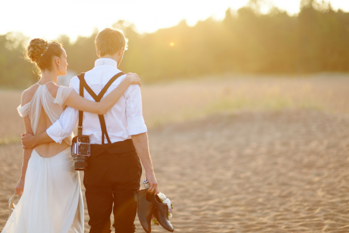 Bride and groom from behind at sunset