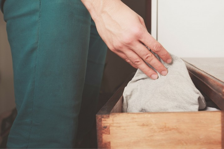 Man getting underwear out of drawer - underwear subscription