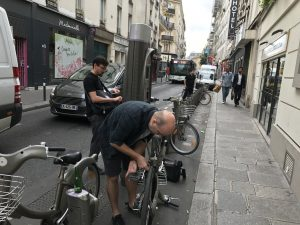Man trying to unlock street bike in Paris