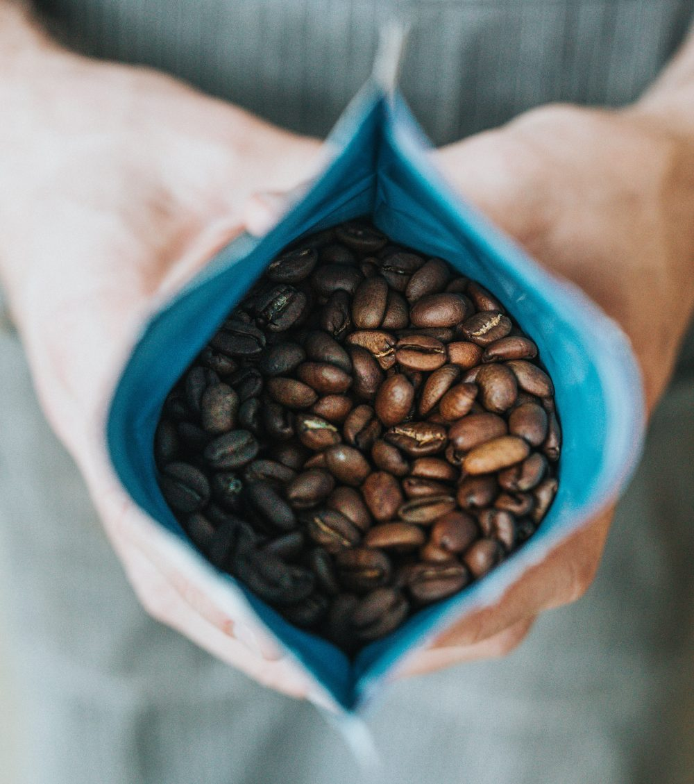 Bag of coffee beans being held open