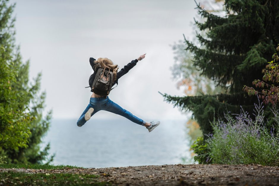 Blonde girl jumping in excitement