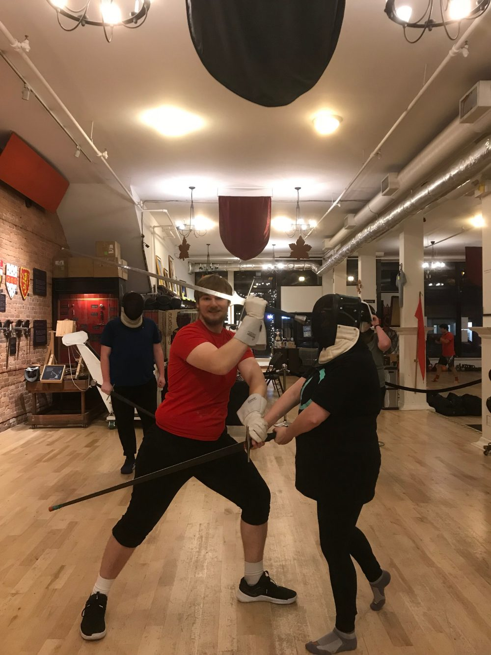 Jillian sword fighting with instructor